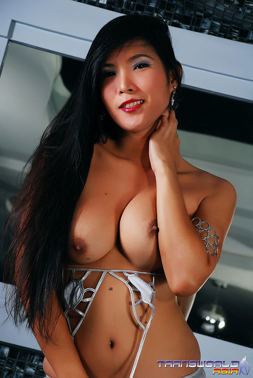 A Brunette Thai Tgirl With A Provocative Face Flashes Off Her Body