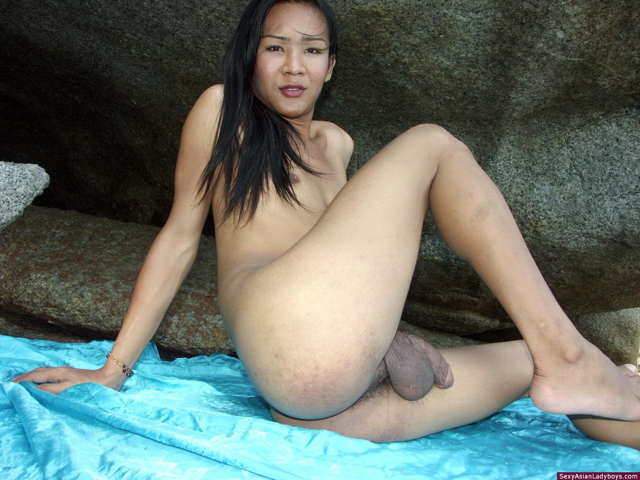 Innocent T-Girl With A Small Body And Enormous Balls Shooting A Load Of Cum On The Beach