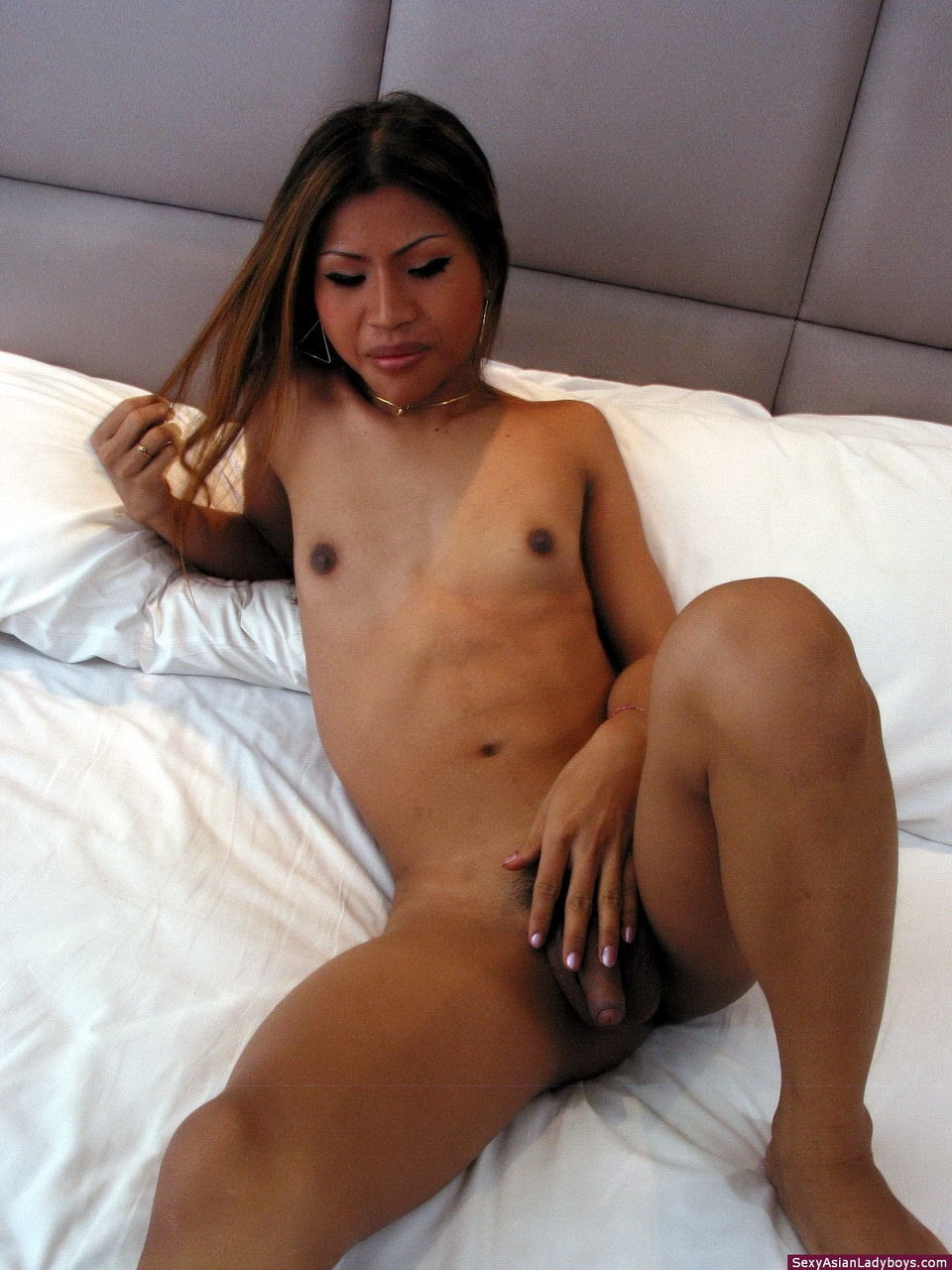 This Tall Cutie Strips On Her Bed And Plays With Her Raw Penis