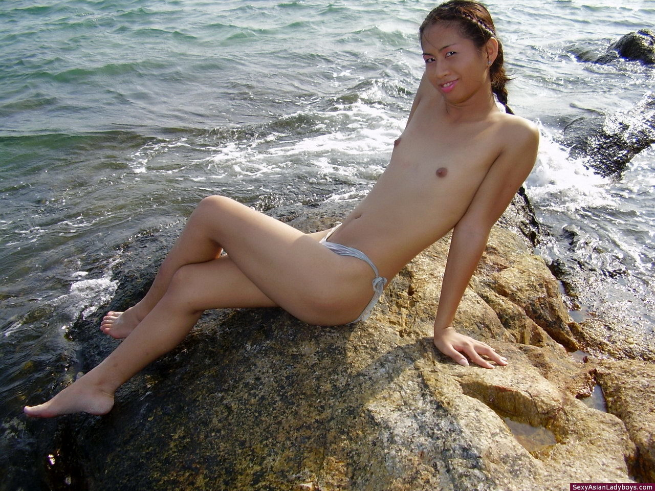 Tiny Tranny Showing Her Charms On A Tropical Beach